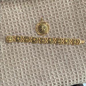 Woman's Gold & Black Bracelet with Pendant